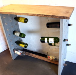 Our concrete console table with wine rack